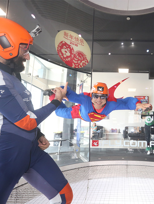 Man Dressed as Superman indoor skydiving